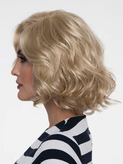 Coco's artfully curled layers add a touch of flirty sophistication