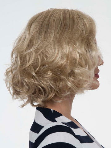 "Embraces that retro glam look in this bouncy, mid-length ""bob."""