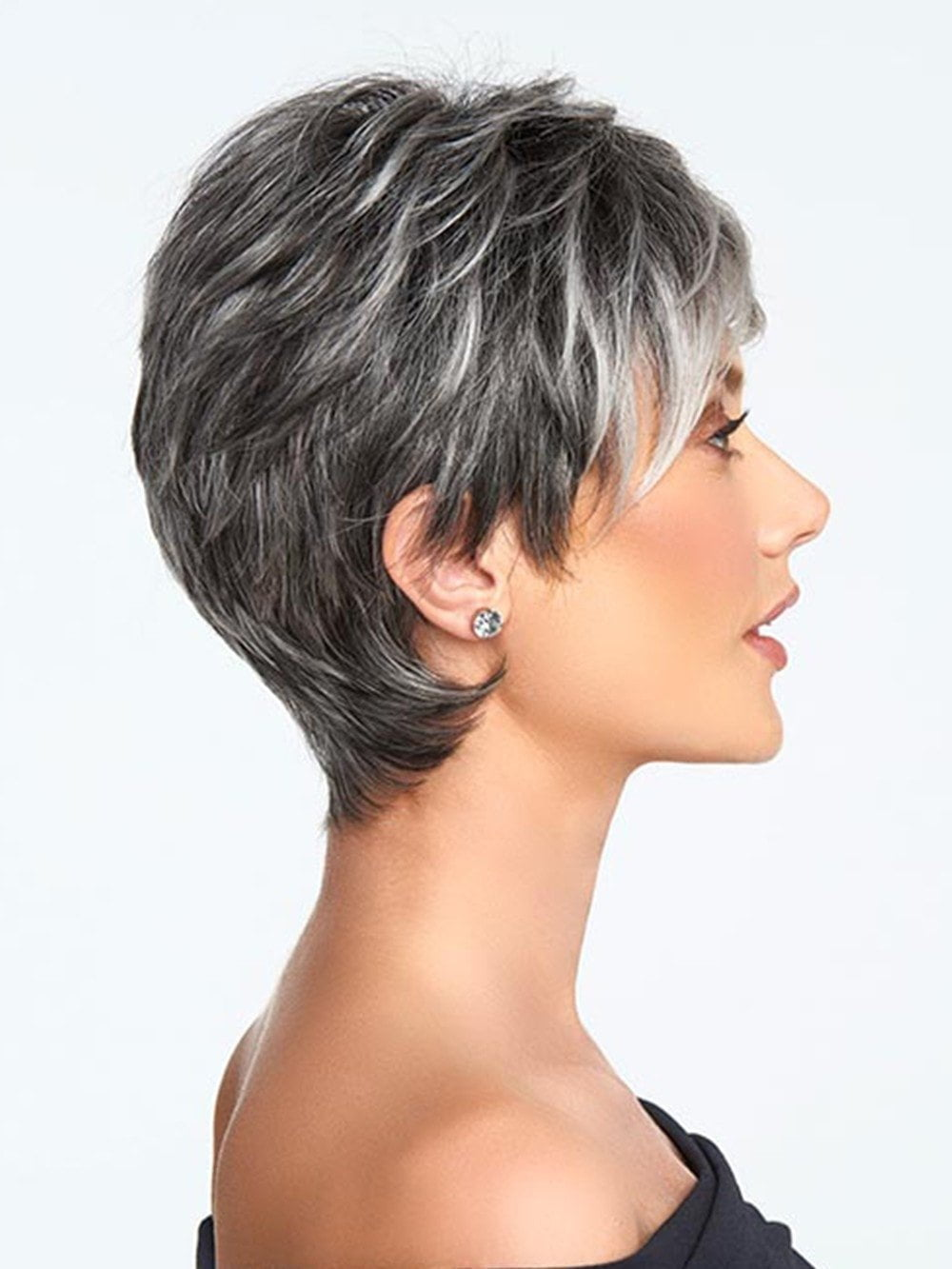 The slightly angled fringe can be worn onto the face or swept away while the razor cut nape creates a soft clean look in the back
