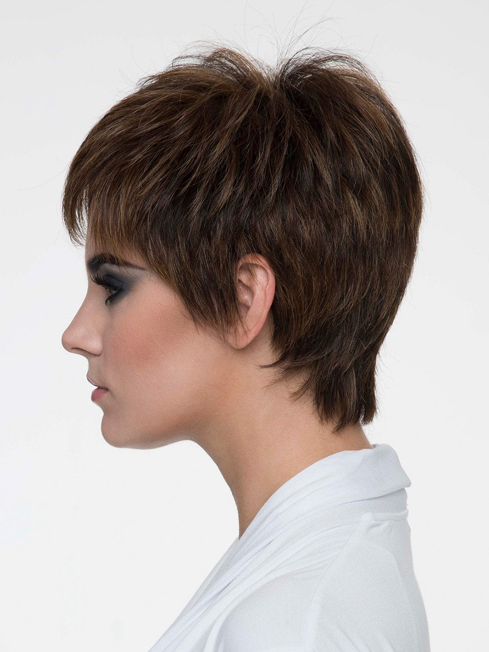Flat iron for a spiky edge or heat roll for a softer appearance