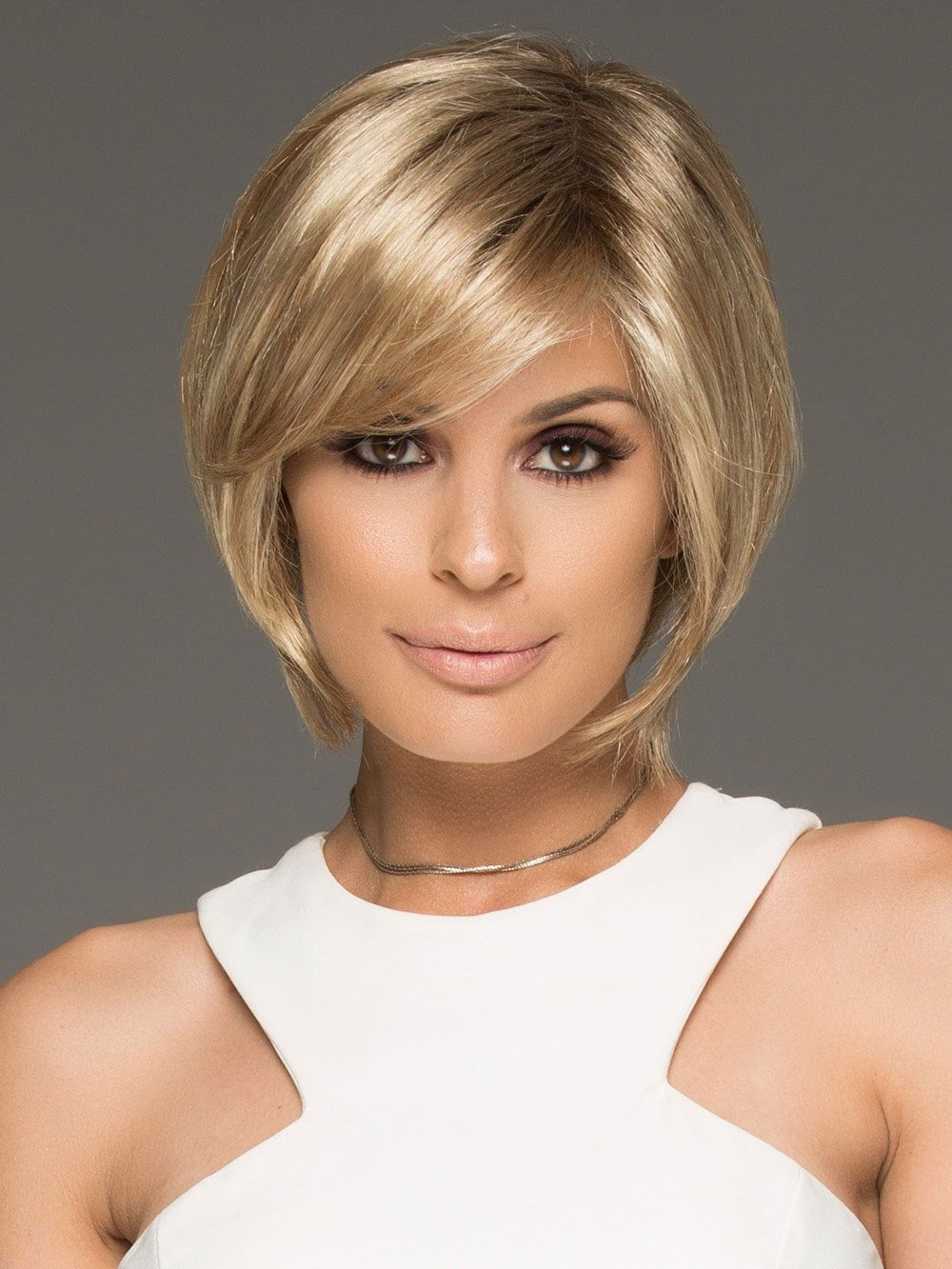 The fringe falls at eye level and is able to be pulled back or swept to the side with ease. The perfectly placed layers are texturized to provide light, airy movement