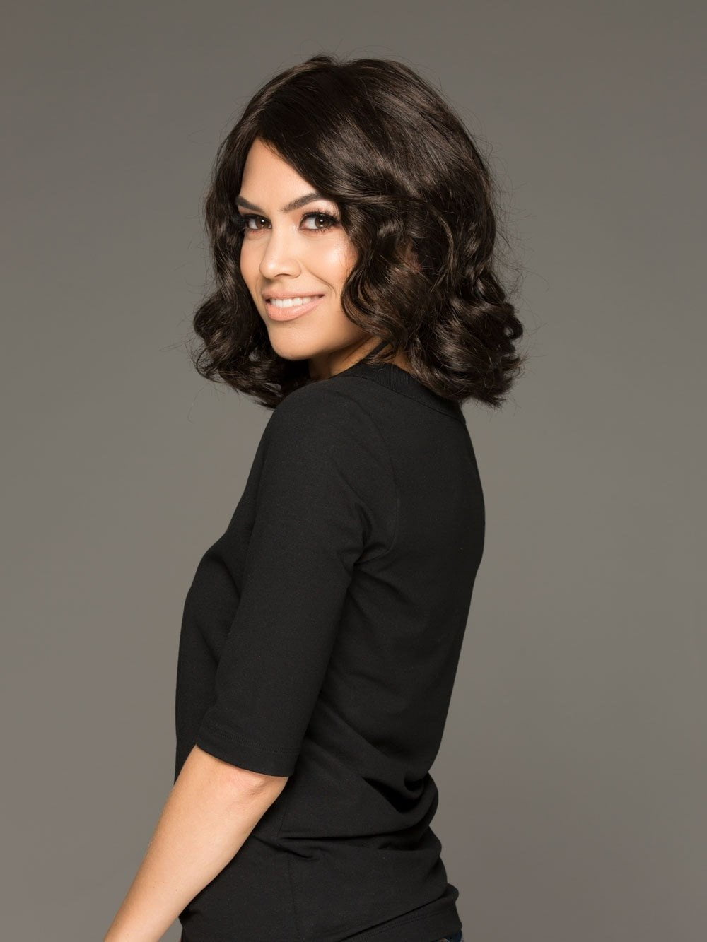 Envy Brittaney is a loosely waved, long bob wig that's glamorous and ready to wear