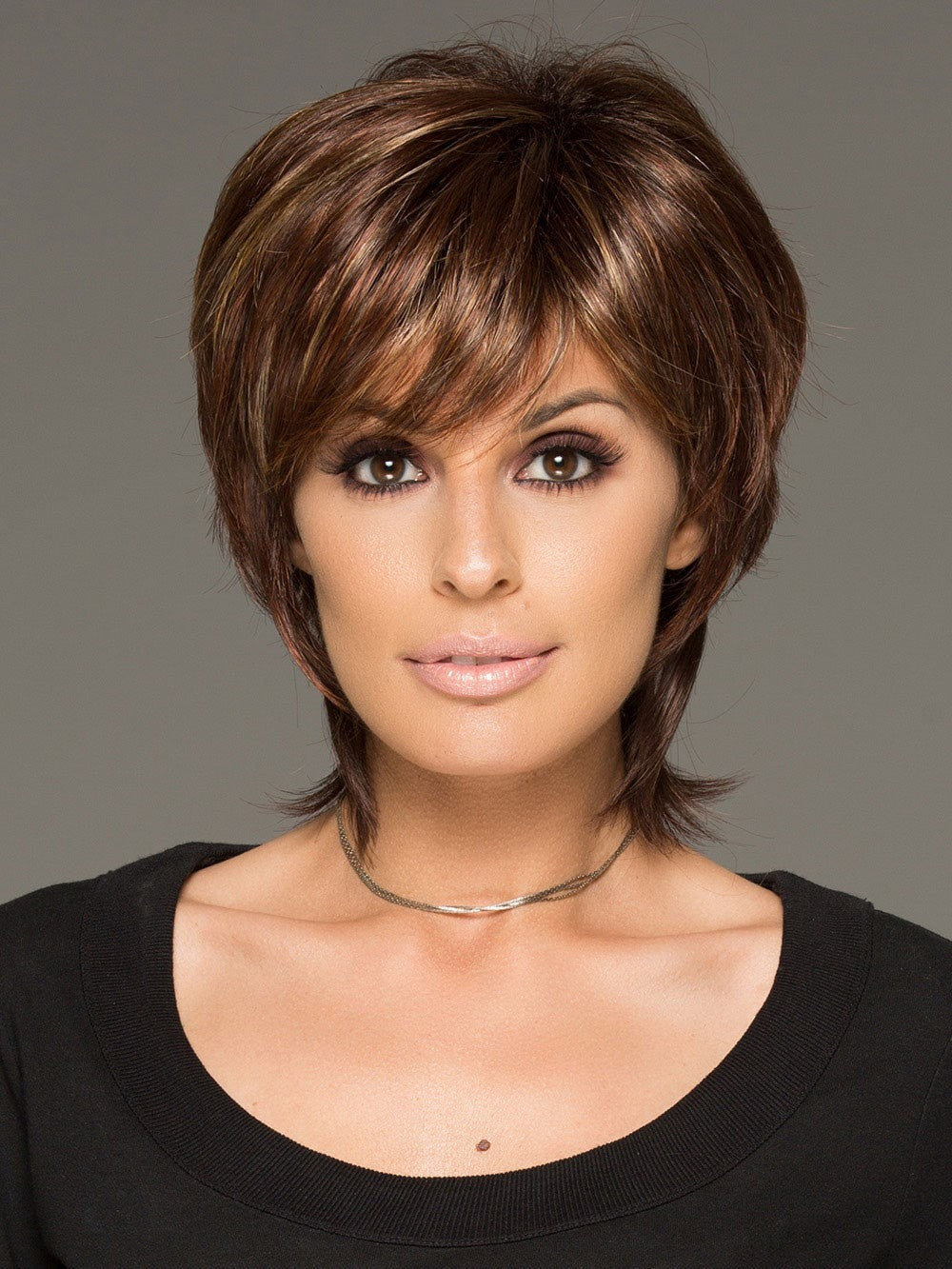 This tousled short wig has gorgeous layers and a long wispy nape for a new trend in today's fashion forward looks