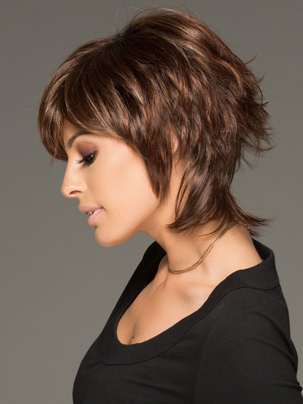 his cutting edge hair style has gorgeous layers and a long wispy nape for texture & easy styling