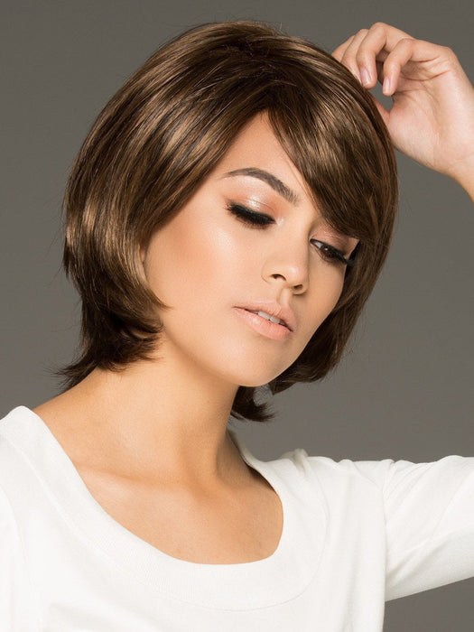 This chic coif boasts soft layers and a stacked neckline that come together to create a show-stopping silhouette.
