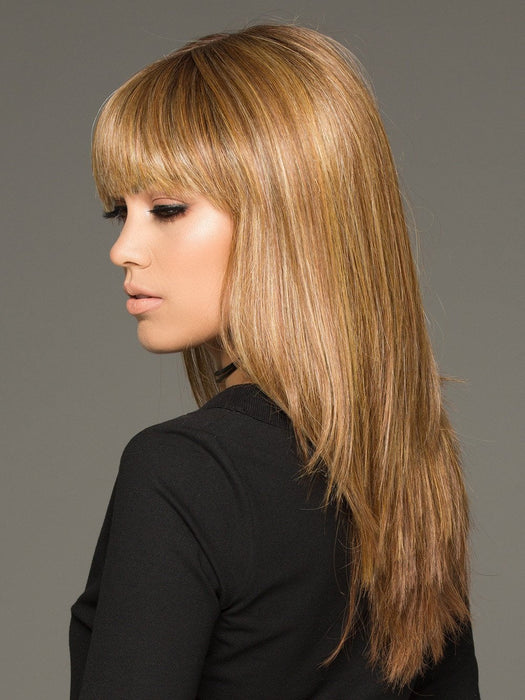 The Envy Taryn Wig is a long, sleek, and modern hairstyle with a blunt bang (This piece has been styled and straightened)