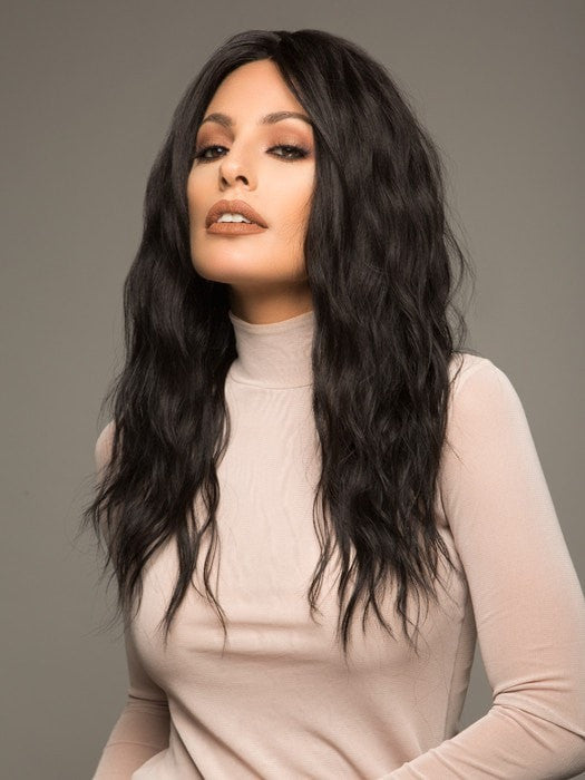 A wavy wig with long layers and a center part