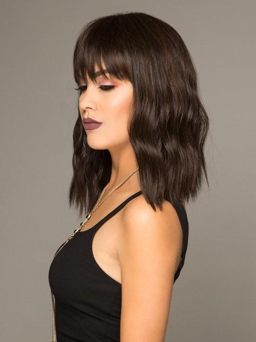 A mid-length cut with full bangs and the perfect wave