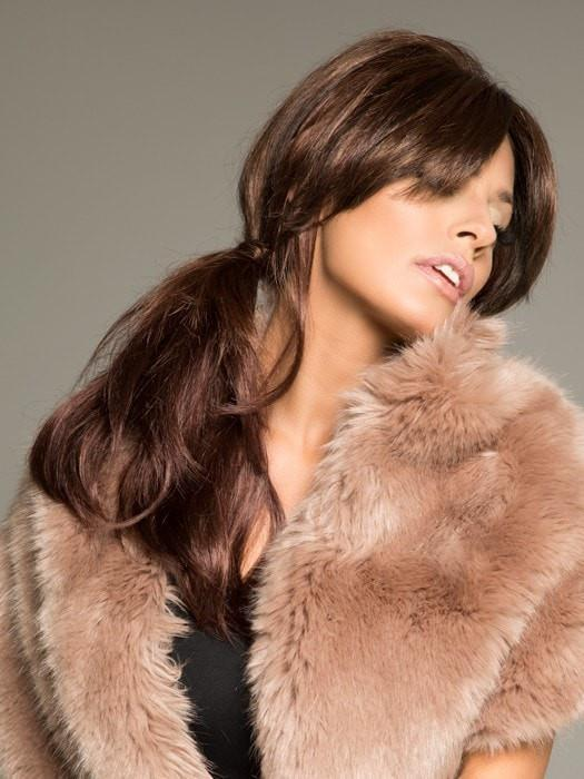 Brooke by Envy is a long, layered, and glamorous synthetic wig.