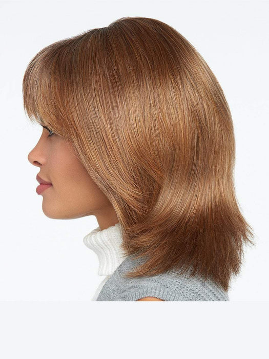 This precision crafted collarbone length cut reflects a popular trend offered in today's top salons