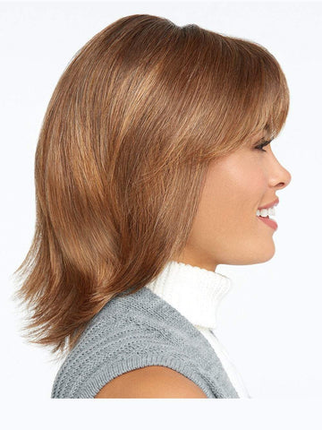 Featuring razor tapered bangs that blend into long razor-cut layers in the sides and back