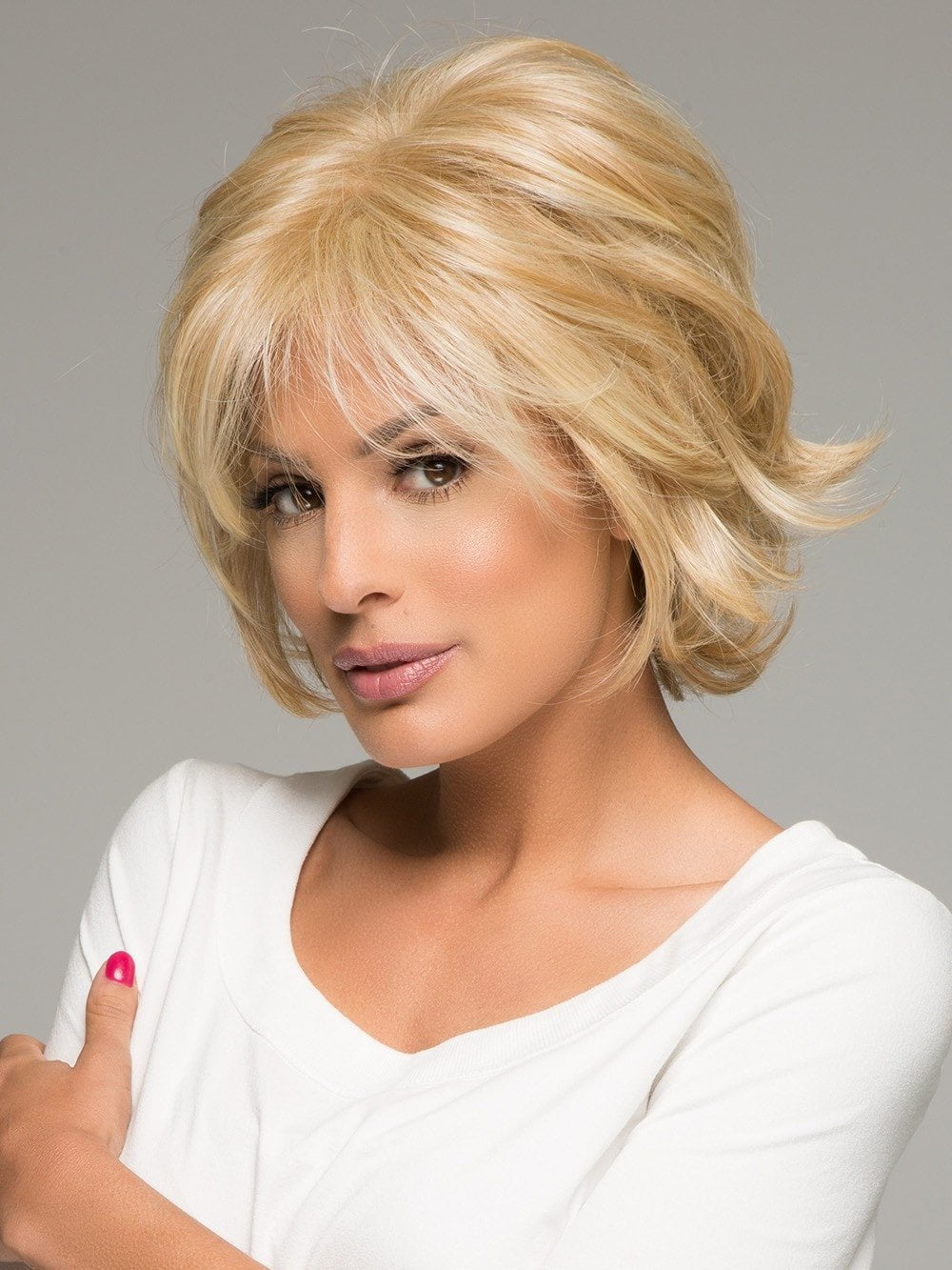 Jon Renau Naomi is a layered and lovely short wig. Flirt with the endlessly layered styles of this chin length shag