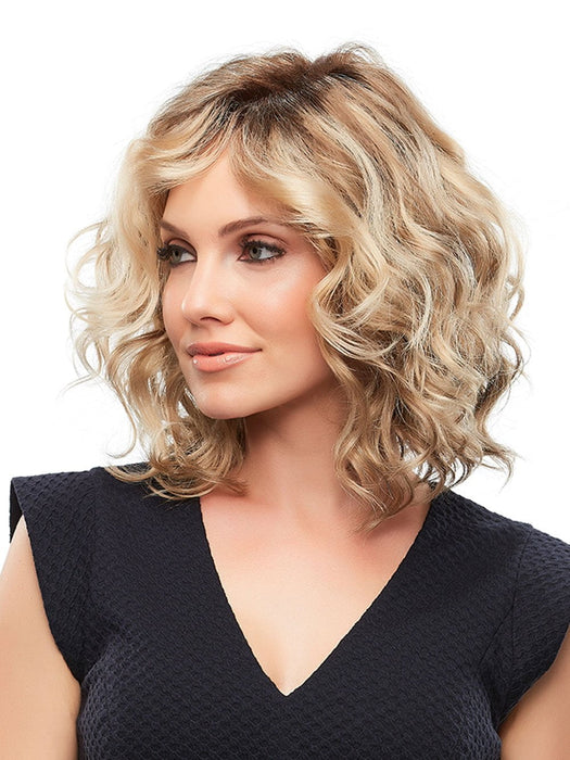 Welcome the sunshine with the effortless beach waves of this assymetrical style.
