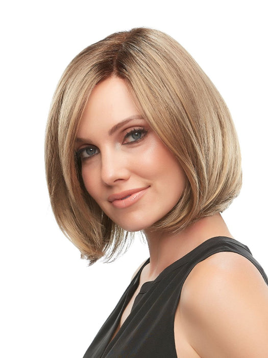 Kristi's face framing layers and medium length cut are sure to be a hit.