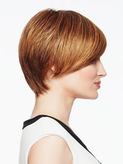 This short wig has a asymmetrical cut and added length on the right top and side.