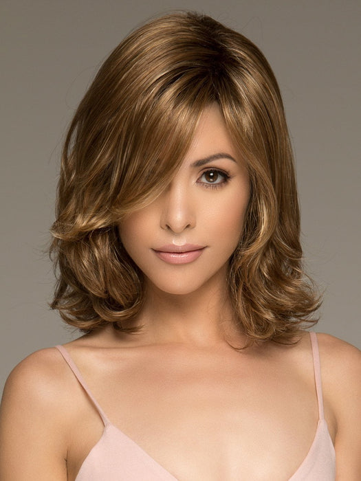 The Carrie Wig by Noriko is a medium length style that has a balanced body evoking a romantic quality sure to capture attention