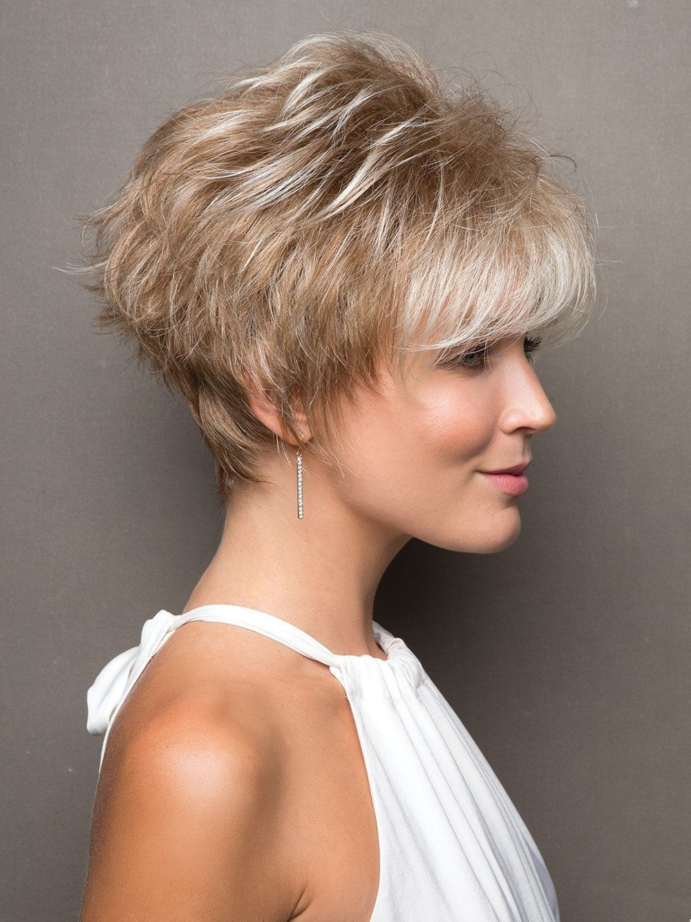 Bold multi-layered style is full of texture and hugs the nape with tapered edges.