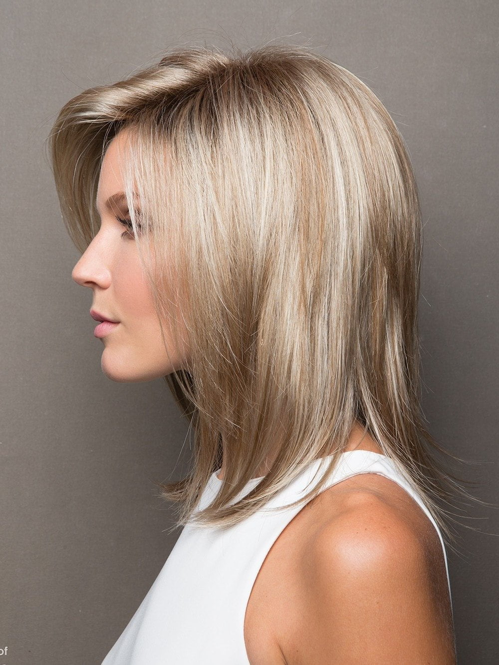 Jackson by Noriko is a voluminous, layered mid-length cut. It embodies feminine style with its subtle pointed ends and modern tease.