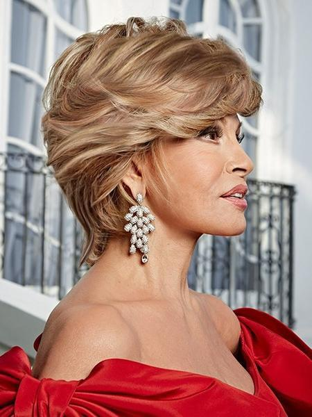 APPLAUSE by Raquel Welch is a below-the-collar wig with all over, precision tapered layers | Color: R29S+ Glazed Strawberry