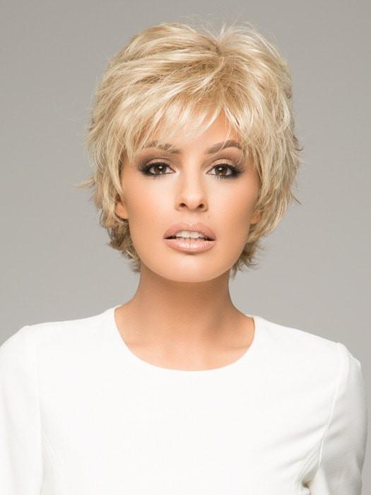 This short style is bold, textured, and features all-over layers that are feathered to perfection