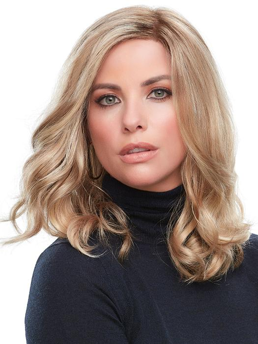 Romantic loose waves that roll gently below the shoulders in this easy-going style