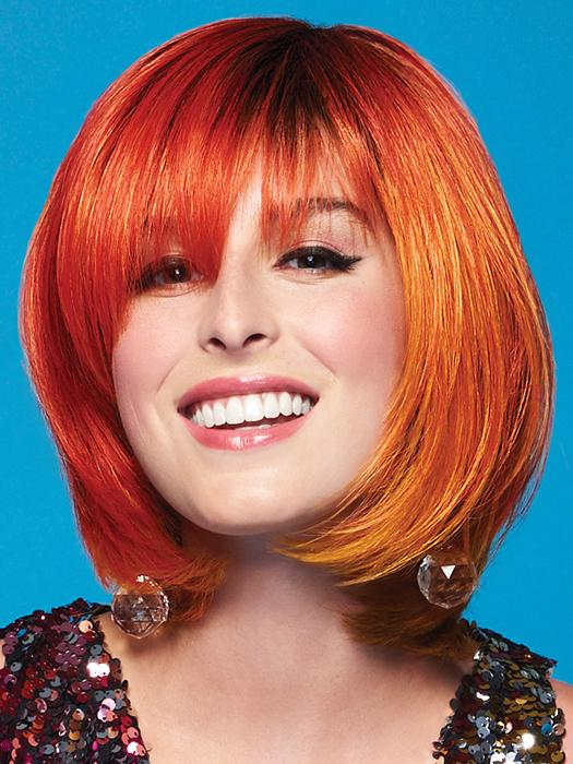 The Fierce Fire Wig by Hairdo embraces your fierceness in shades of flaming orange