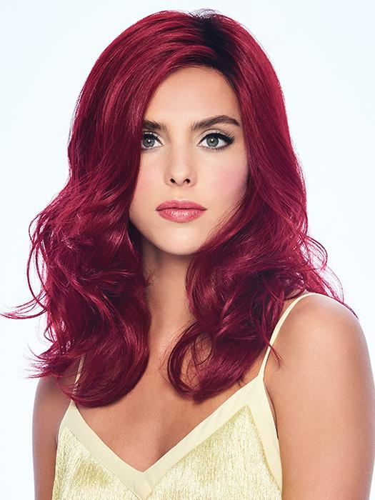 The Poise & Berry Wig by Hairdo has long voluminous locks in an intoxicating cranberry red hue
