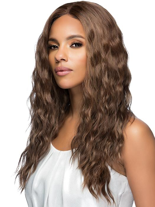 A long, layered style with loose body waves and an invisible center part