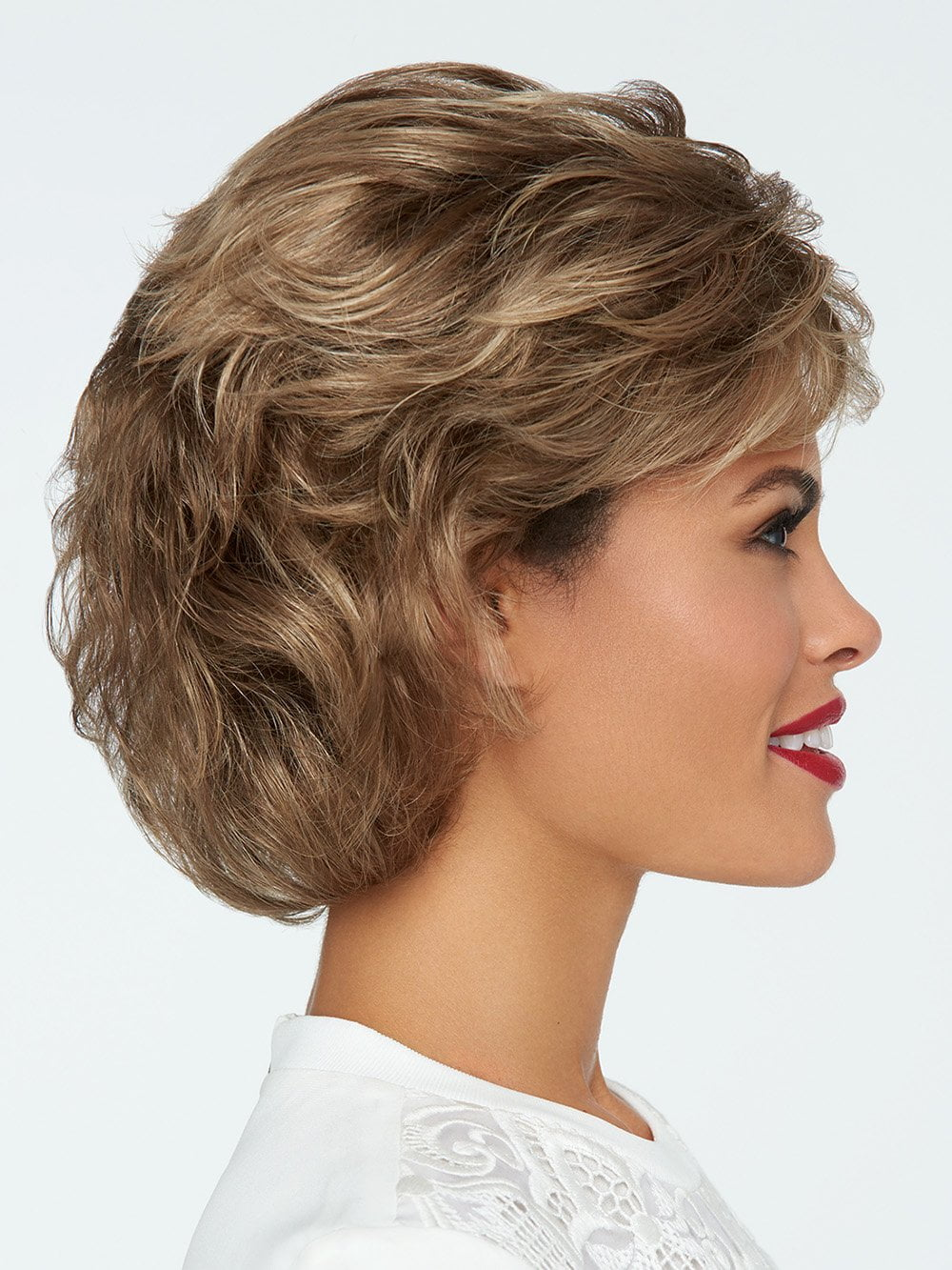 This textured, wavy style features all over layers, soft body and curls.