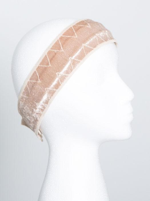 Lined with a patent-pending silicone non-slip grip strip for those with thinning or no hair