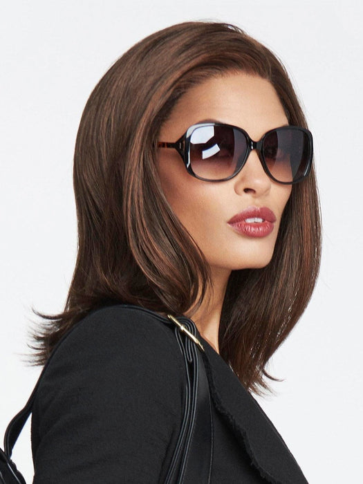 A below-the-shoulder bob, this sleek, silhouette is punctuated with light texture to frame the face