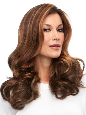 Worn over the part and adds volume to longer hair styles