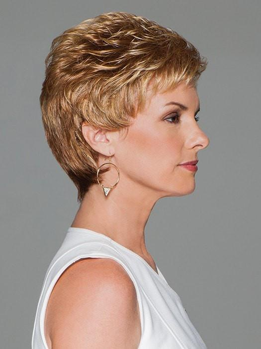 A short, boy cut style featuring all-over layering and loose curls for gorgeous volume