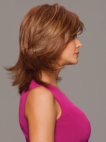 Layered cut with volume at the crown and softly flipped ends | Color: Medium Red
