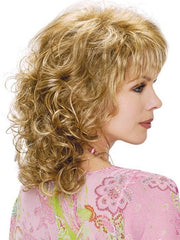 Shoulder length cut with soft spiral curls and straight bangs