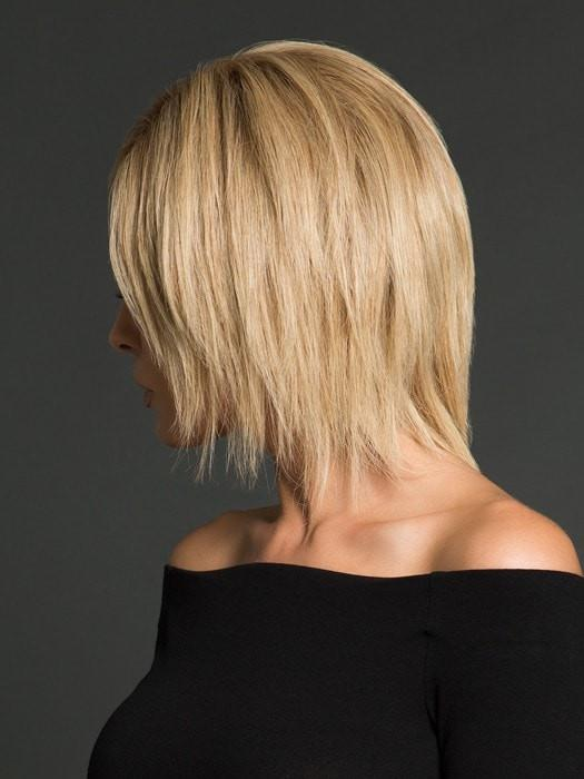 Un-cut and styled straight with a flat iron