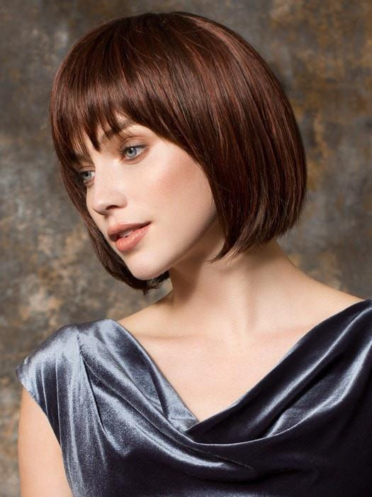 Have your stylist trim the bang to fit your face shape
