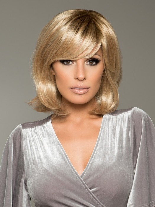 A shoulder length bob with a clear parting and a long, seductive fring