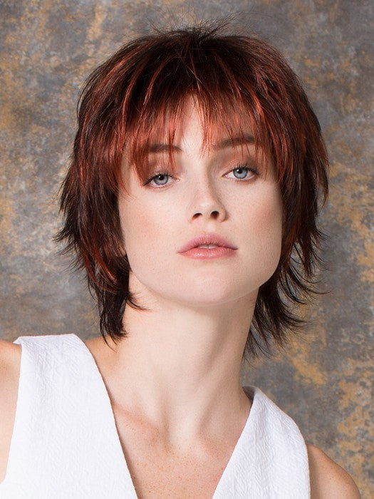 Modern cut with bangs and fashion forward colors