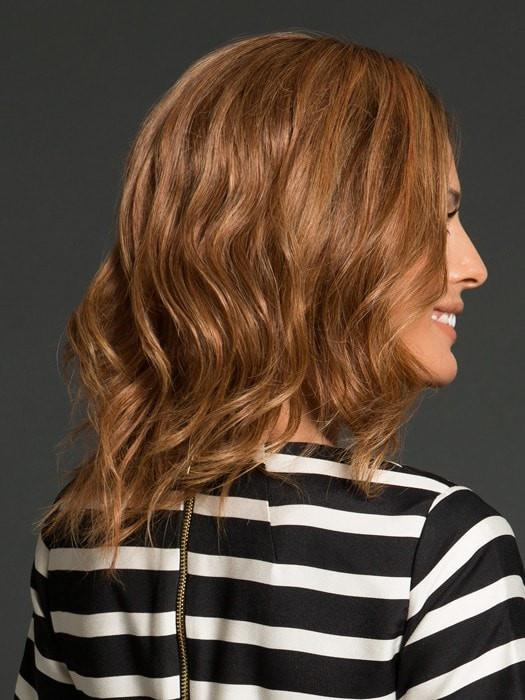 Styled with a center part and loose curls