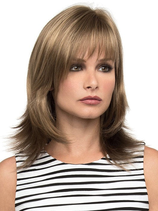Features long layers and wispy face framing bangs | Color: Almond Breeze