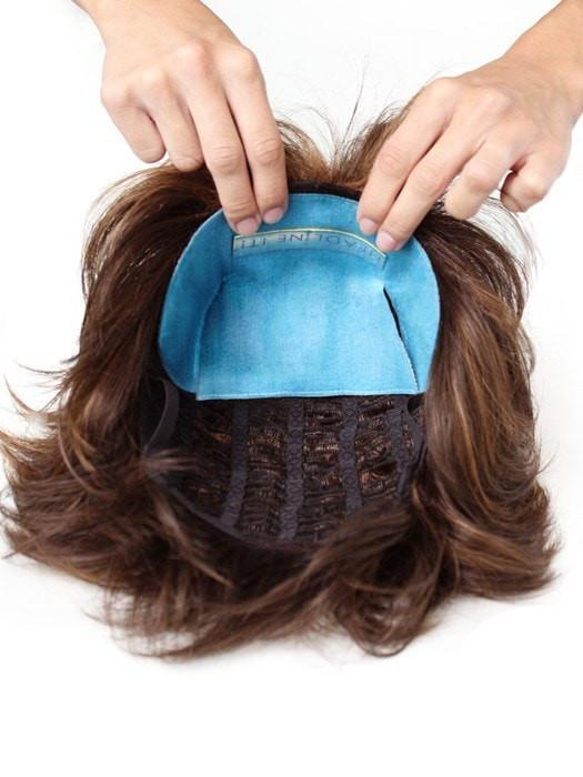 Remove the adhesive strip and apply the tan colored side to your wig, the soft blue material will touch your head and scalp.