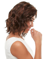 Effortless beach waves creating a casual chic look on this mid-length wig
