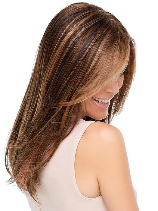 The ready-to-wear synthetic hair topper, looks and feels like natural hair