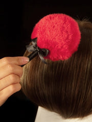 The Wig Wand magically eliminates shine from synthetic wigs.
