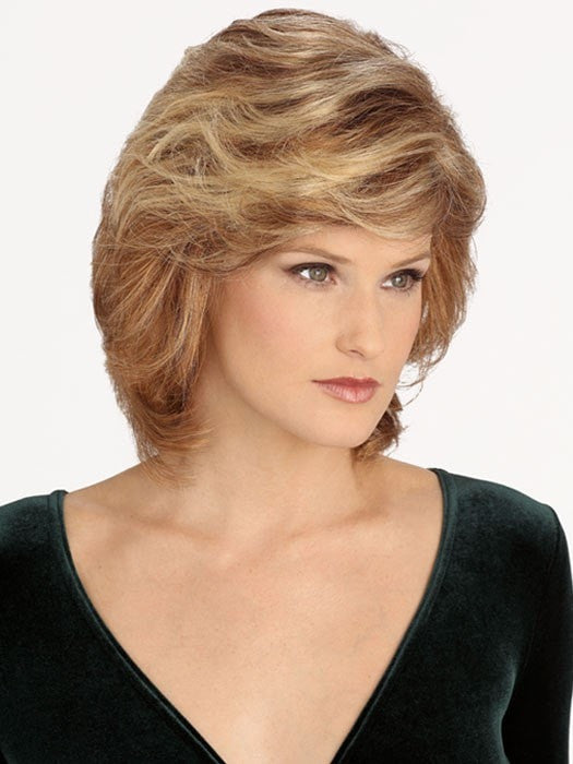 Featuring a monofilament top, this wavy synthetic hair wig allows styling versatility with a natural looking part.