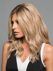Longer fringe around the face that compliments the tight curls and subtle layers