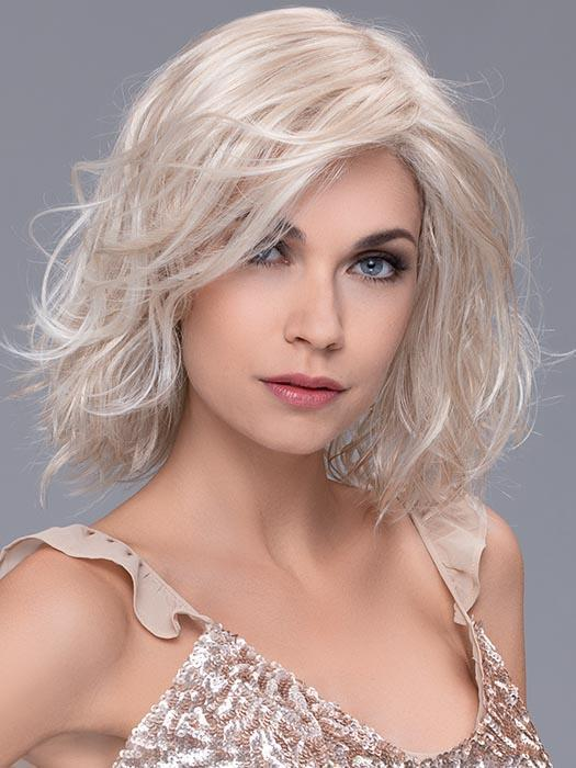 A shoulder-length style with loose beach curls and an undetectable extended lace front hairline