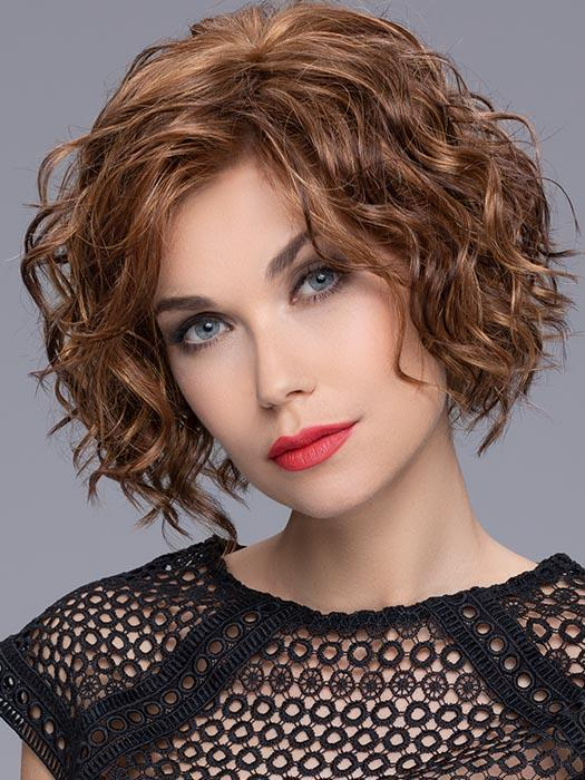 Turn is an ultra-gorgeous, mid-length style full of curls throughout