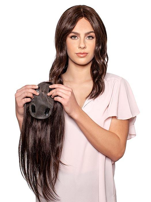 A light human hair topper that allows the hair to fall in all directions.